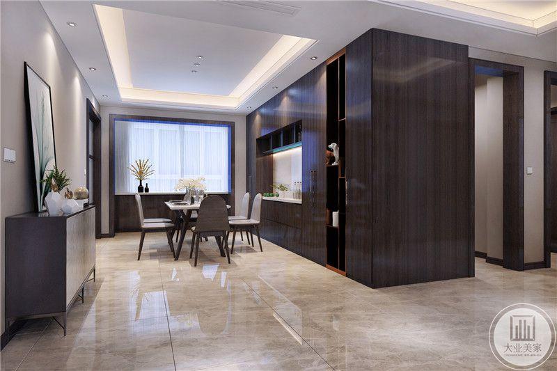 餐厅餐桌餐椅都采用现代风格,一侧的墙面采用黑檀木收纳柜,增强收纳空间。