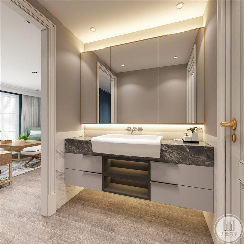 卫生间装修效果图:门口的是陶瓷的洗手盆,搭配黑色大理石台面。