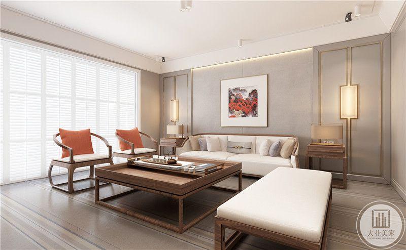 客厅影视墙采用灰色壁布,两侧采用墙面悬挂中式水墨画装饰,沙发茶几采用实木材料。