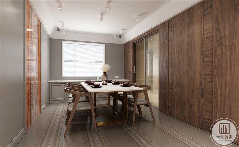 餐厅餐桌采用现代风格,餐椅采用实木材料,墙面采用实木背景墙。