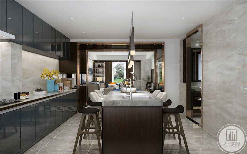 餐厅岛台采用深色实木材料,台面采用大理石台面,同时增加洗手赤。