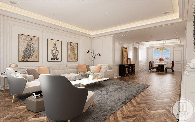 黑白布艺圈式沙发椅,柔软舒适,加长设计留给双腿休息空间,实用性强,墙面每个隔断都装饰艺术画作,整体时尚大气,散发浓郁文化气息。