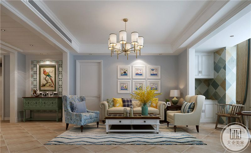 客厅沙发墙采用蓝色装饰,墙面用六幅现代抽象画装饰,沙发次用米色和蓝色搭配,地面铺设花砖搭配浅蓝色地毯。