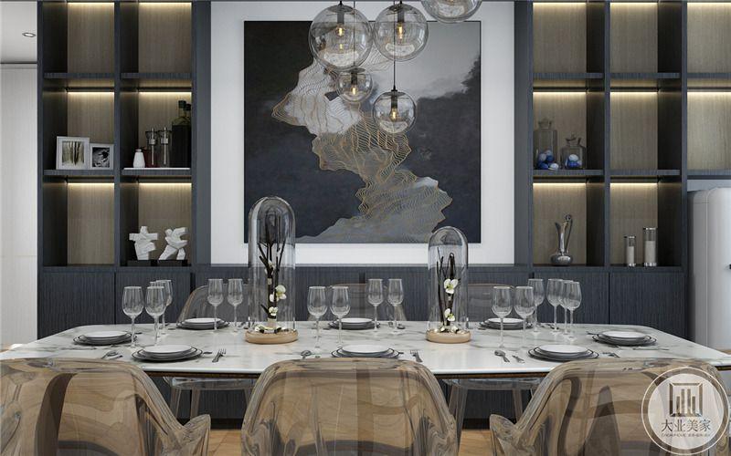 餐厅一侧的墙面做成黑色收纳柜,同时摆放现代抽象画,搭配白色的简约风餐桌。