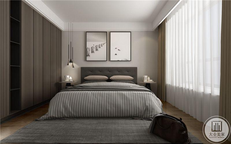 卧室床头背景墙采用浅色墙纸,墙面采用两幅现代抽象装饰画,床的两侧采用先打简约的床头柜