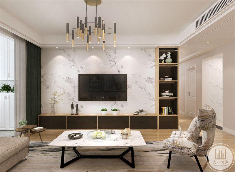 客厅电视墙是白色的大理石板,电视柜做成L形,大大增加了收纳空间 。