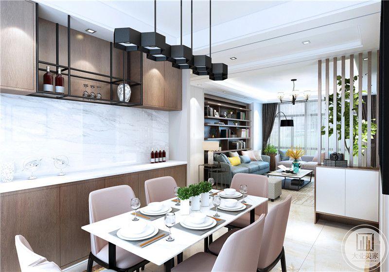 餐厅餐桌采用现代风格设计,餐椅采用粉色装饰,一侧的橱柜采用实木装饰。