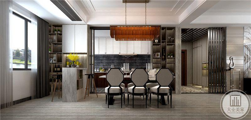 餐厅餐桌采用先打风格装饰布局,靠窗的一侧设置吧台,从这里可以看到厨房的部分布局装饰。