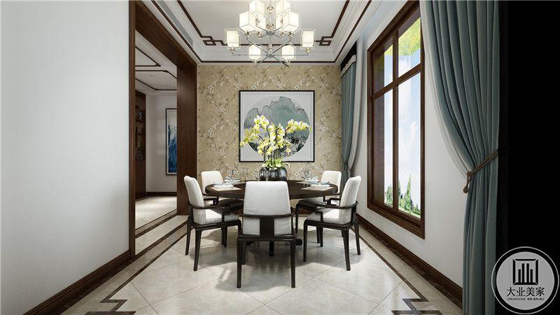 餐厅背景墙面采用浅黄色壁纸,墙面采用中式山水画装饰。