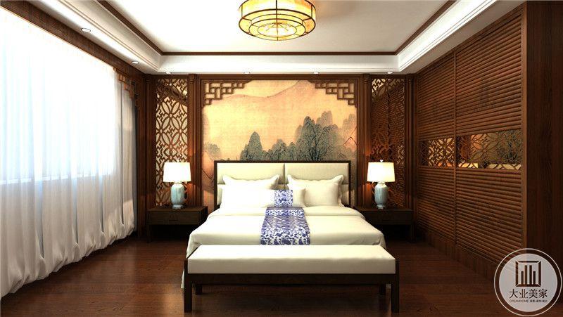 主卧室床头背景墙采用中式山水画壁纸做装饰,床的两侧是中式红木床头柜。