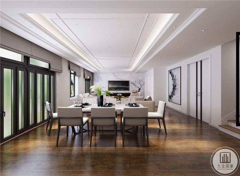 餐厅餐桌采用现代风设计,搭配白色餐椅,餐桌的一侧就是一扇入户门。