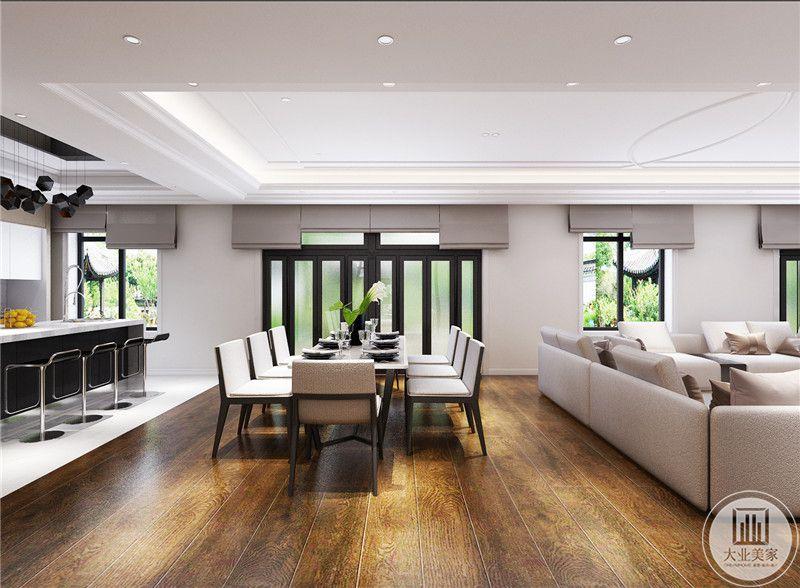 餐桌是六人的长桌,餐桌左侧是吧台的设计。