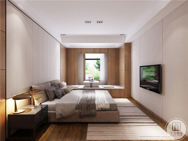 卧室床尾采用电视,搭配白色壁纸的设计。