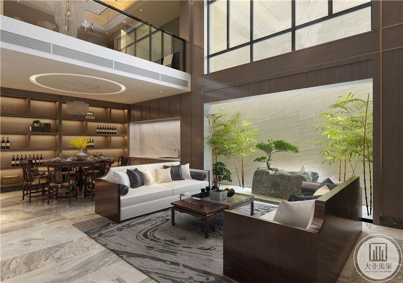 客厅装修效果图:客厅地面采用浅色瓷砖,搭配深色地毯,沙发茶几以实木为主,沙发背面就是餐厅餐桌餐椅。