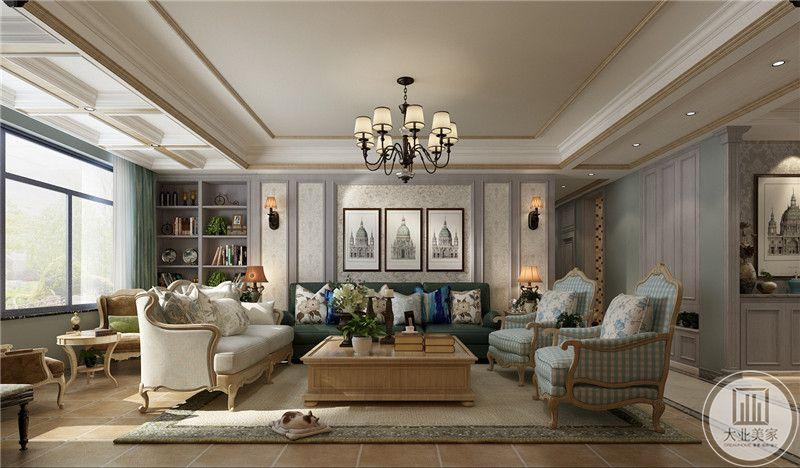 客厅沙发墙采用欧式白色壁布装饰,墙面采用三幅景物画装饰,沙发采用绿色和蓝色搭配,茶几采用实木材料。