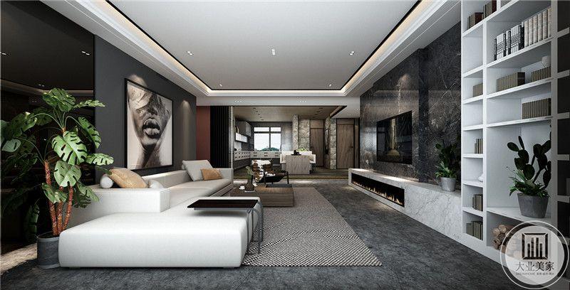 客厅是简约的白色布艺沙发。黑白相间的地毯占据了客厅的大半空间,深木色的精巧茶几baiza
