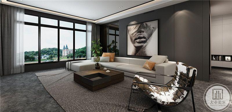 客厅是经典的黑白灰色系组合,深灰色的沙发墙,浅色的布艺沙发,深木色的茶几以及黑白相间的编织地毯组合,将黑白灰色系运用到了极致。