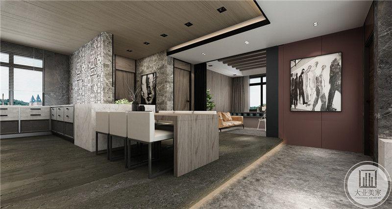 餐桌椅均是极致的简约齐整。餐厅与书房空间临近。在中间的装饰墙涂成暗红色的墙面与中间的黑白画产生强烈的视觉差。