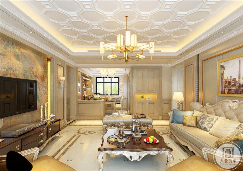 客厅装潢华丽贵气,典雅的欧式皮质沙发与布艺抱枕的结合更显温暖。方形的花腿茶几是欧式的优雅精致。