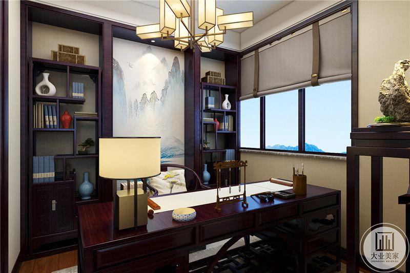 书桌书柜都采用黑檀木,背景墙面采用中式山水画装饰。