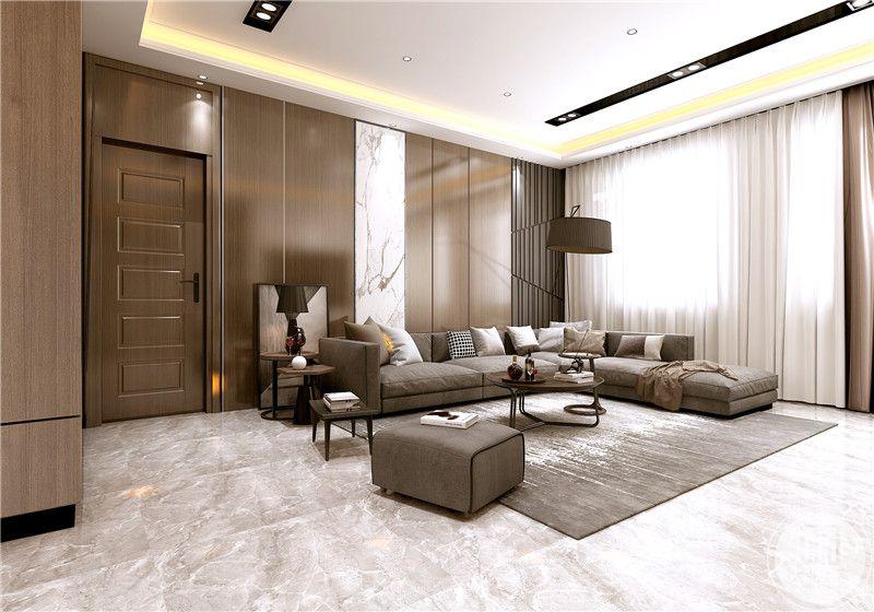 客厅沙发墙采用深色实木板制作,装饰画采用中式风格装饰,沙发采用灰色布艺沙发,搭配黑色茶几,地面采用浅色瓷砖搭配深棕色地毯。