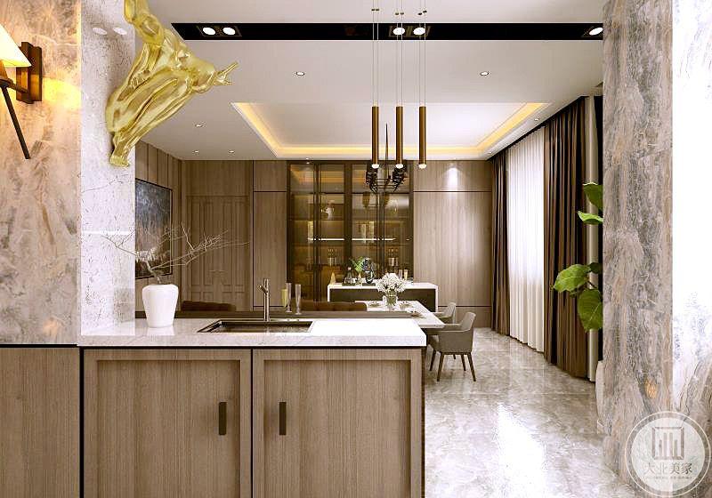 厨房与餐厅通过洗手盆区分开,台面和墙面都采用大理石装饰。
