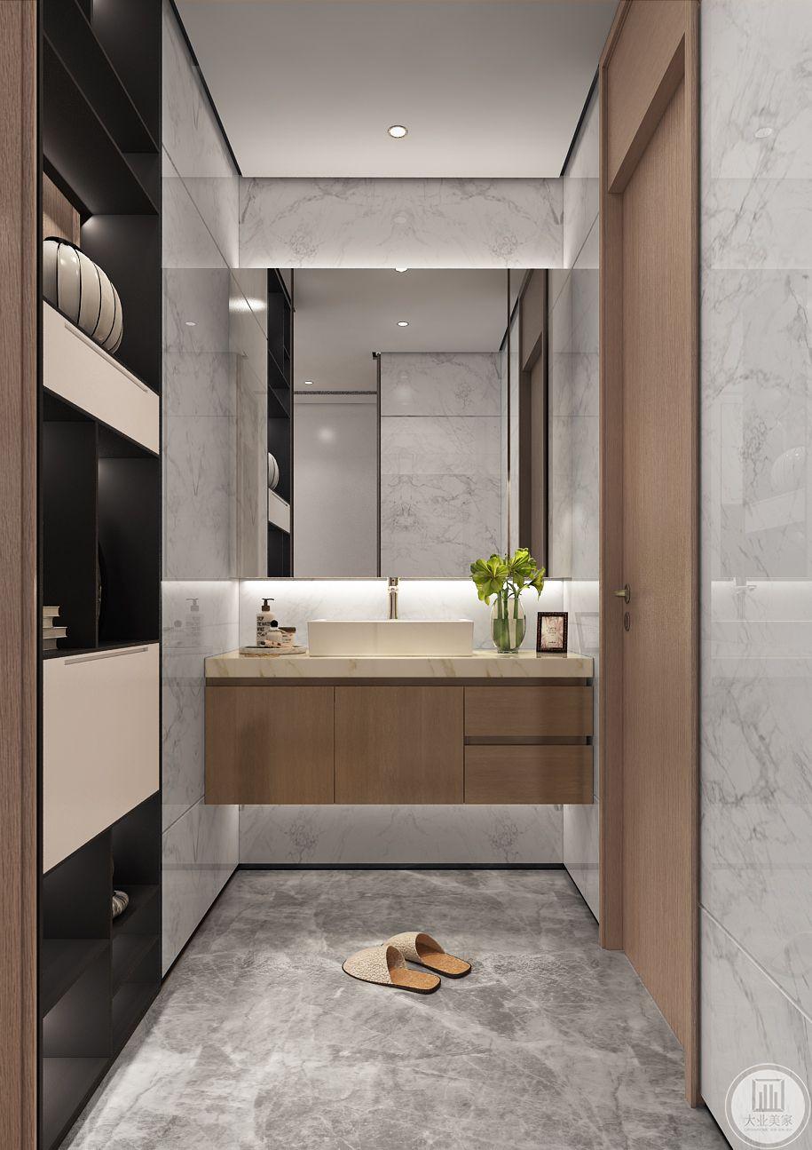 卫生间盥洗室洗手盆采用浅黄色瓷砖,地面铺设花纹砖。