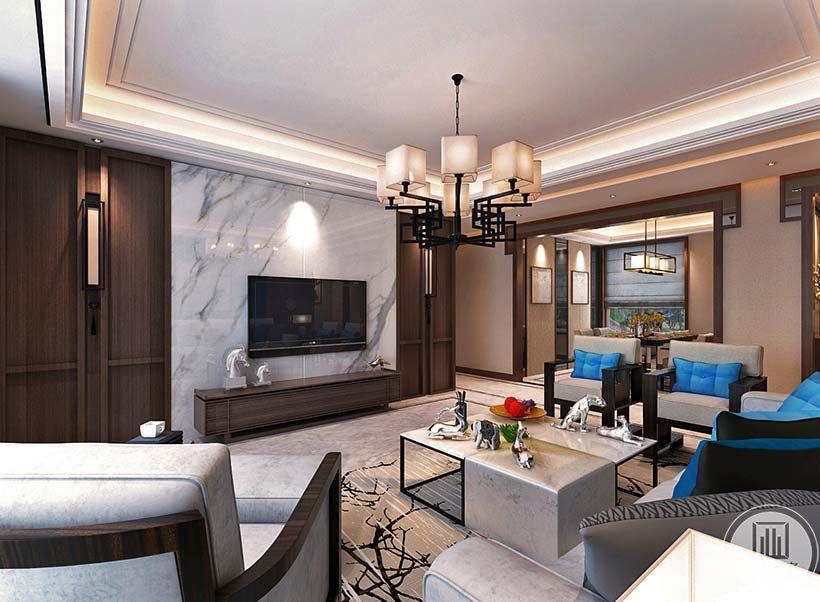客厅电视墙是浅色的大理石板,下方小巧的木质电视柜上摆放着精巧的装饰品。极有设计感的方形茶几上摆着果盘和装饰物。