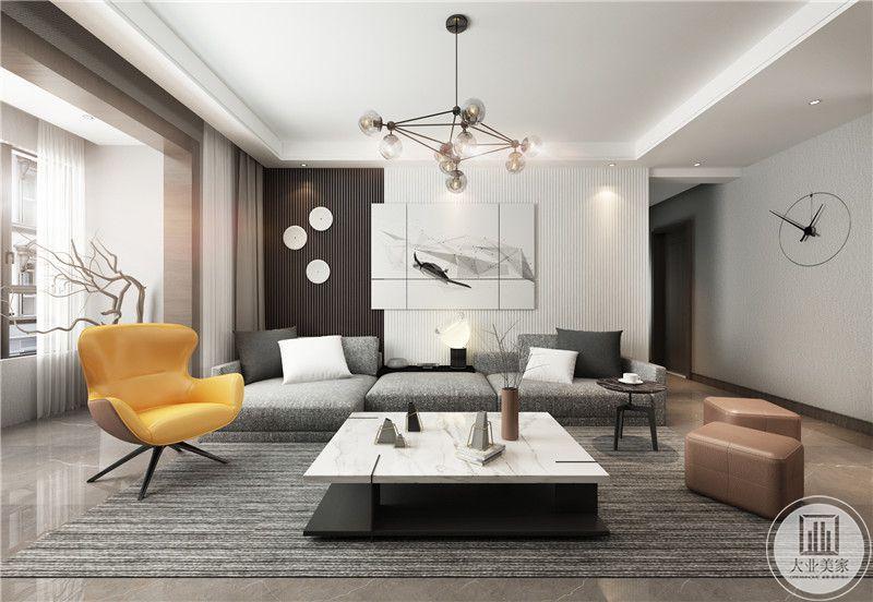 背景墙采用一侧格栅,一侧留白的设计,装饰画采用现代黑白的风格装饰,沙发茶几以灰色为主,搭配黑白相间的茶几,地面铺设深色瓷砖。