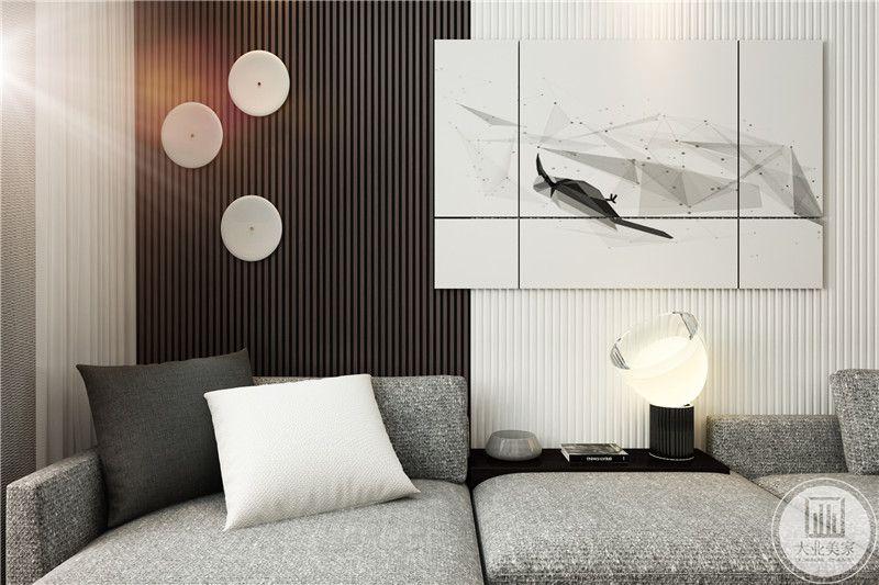 客厅浅灰色的布艺沙发看着舒适柔软,背景墙上的装饰画抽象化的设计理念极其符合整个空间的装修风格。
