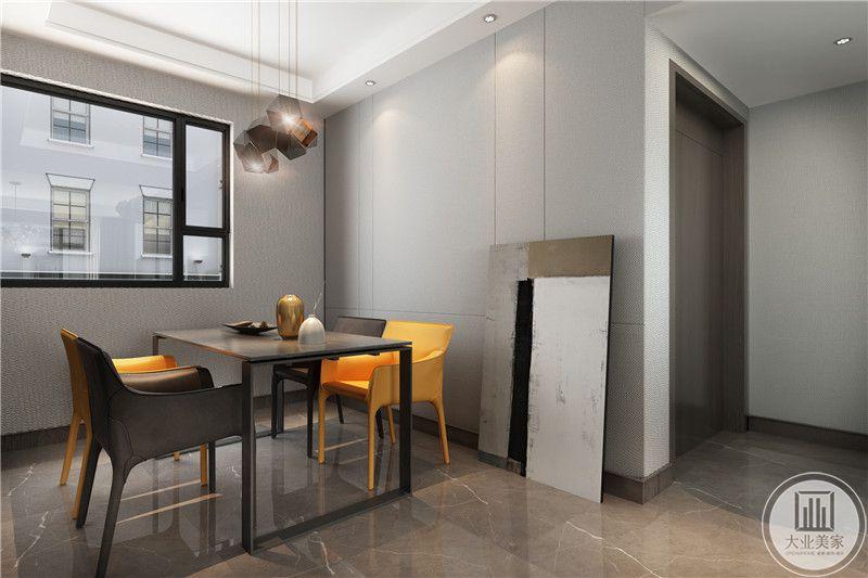 餐厅餐桌采用金属框架,餐椅采用塑料,背景墙采用灰色搭配。