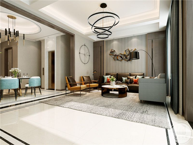 客厅是白色的大理石地面,浅灰色的地毯铺在上面。黑色的皮质沙发与精致的金属色的茶几的配合凸显出现代的奢华感。流线型的吊灯更是显示了设计的时尚感。
