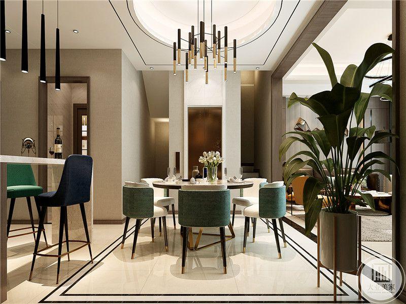 餐厅是简约的桌椅,椅子是薄荷绿的椅面,清新柔软。椅子腿则是呼应轻奢的设计理念,以黑金二色加持。