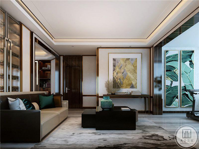 会客室用了皮质的主沙发和黑色的不规则茶几