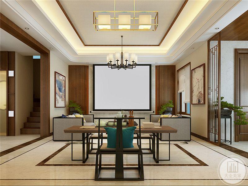 书房与客厅在一个空间里,由简约的桌椅矮榻组成,,正对面是一个投影幕布,闲暇时刻可以边看电影边点茶