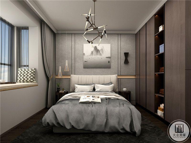 次卧则是简单的银白灰色调,除却棕色的衣橱之外,都是简约的白色和灰色