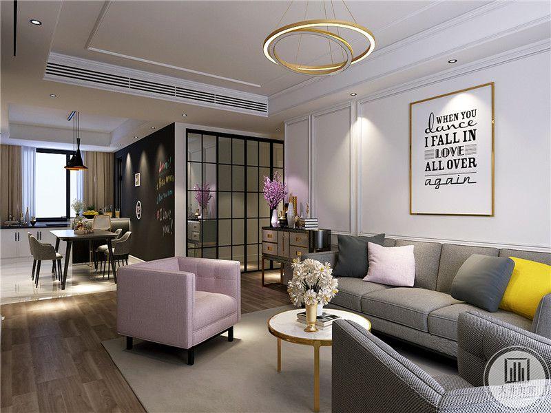 从这个角度可以看到客厅的大半和餐厅的隐约轮廓。客厅的灰色布艺沙发显得柔软舒适,粉紫色的单人沙发使客厅更加温暖明媚,茶几上白色的小雏菊清新淡雅。整体的空间给人一种宜居的视觉感受