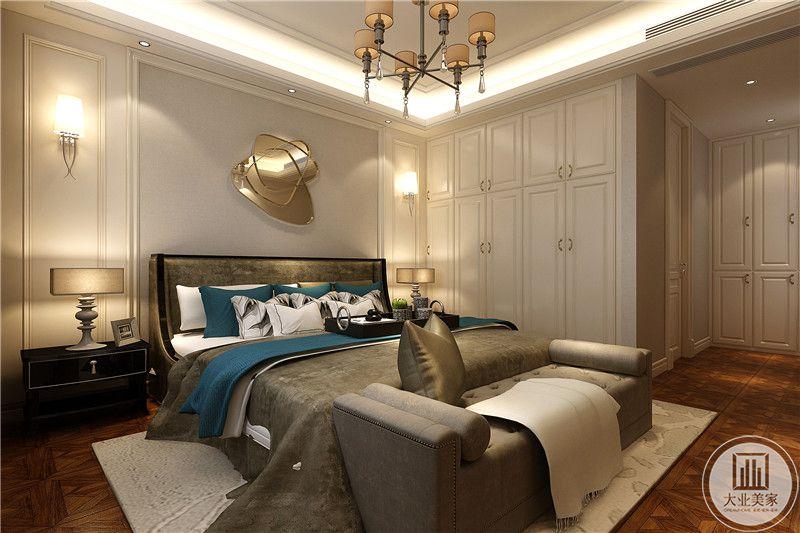 卧室是乳白色的色调,床品吃、却采用了灰色的简约布艺