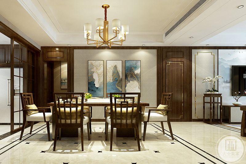 餐厅则是线条丰富的木椅,椅子上铺了白色软垫,一侧的装饰墙上是蓝白的组合挂画