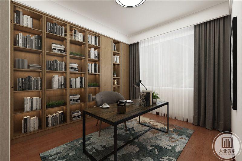 书房是简单的桌椅还有背景墙的书架