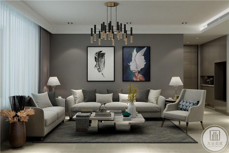 沙发墙是两幅抽象个艺术画,灰色布艺沙发和组合茶几的组合十分亮眼