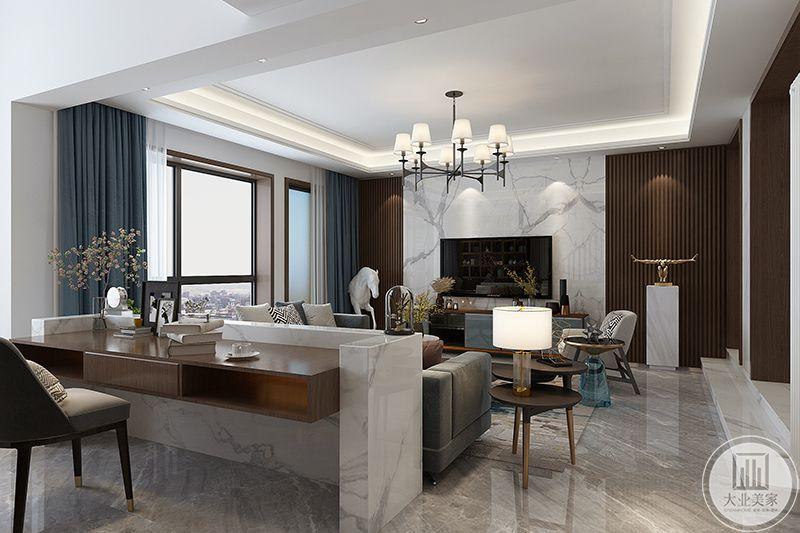 沙发后发空间设置成书房,大理石台和木制品组装的书桌显得十分有设计感