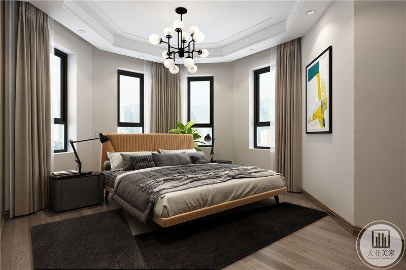 卧室是多棱角的设计,中央是一张双人床,窗户是散开的多个小窗