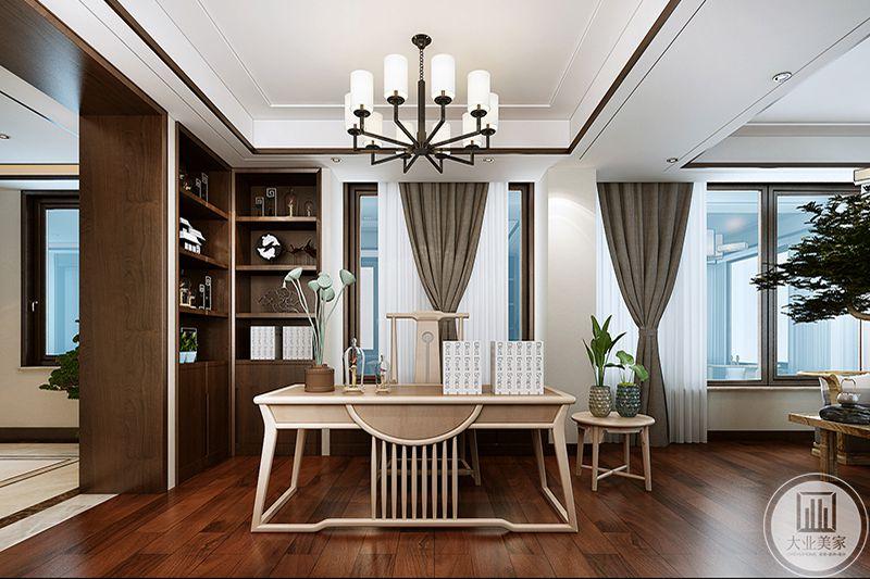 书房是浅木色的色调,中式的木制桌椅,显得极富文人气,空间拐角设计成橱柜样式,放着摆件书籍