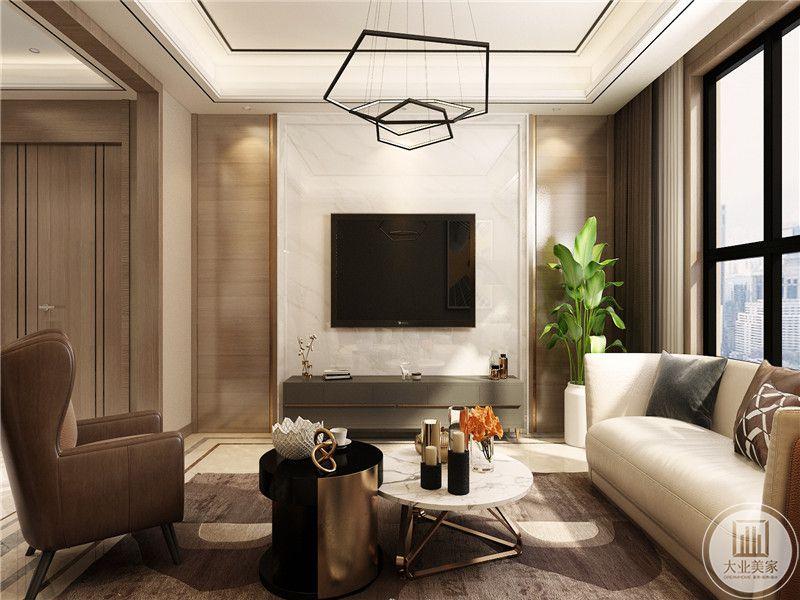 电视墙是米色背景,沙发和桌椅均是米色系的设计