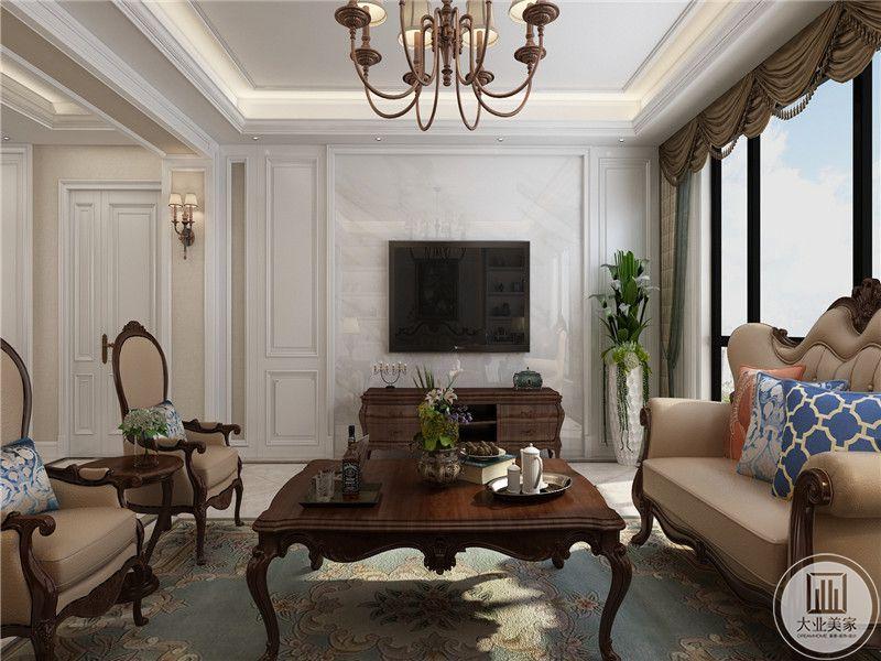 客厅电视墙简单大方,茶几是木质的方桌