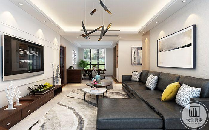 客厅沙发是灰色的皮质沙发,差几十组合式的黑白茶几