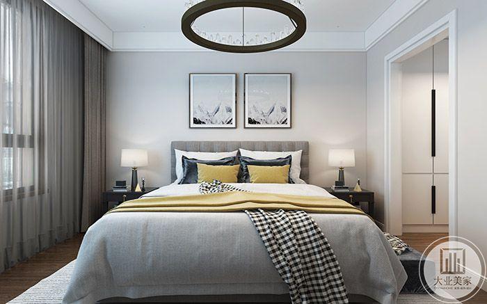 卧室采用浅灰色调,黄色的软枕提亮了整体空间