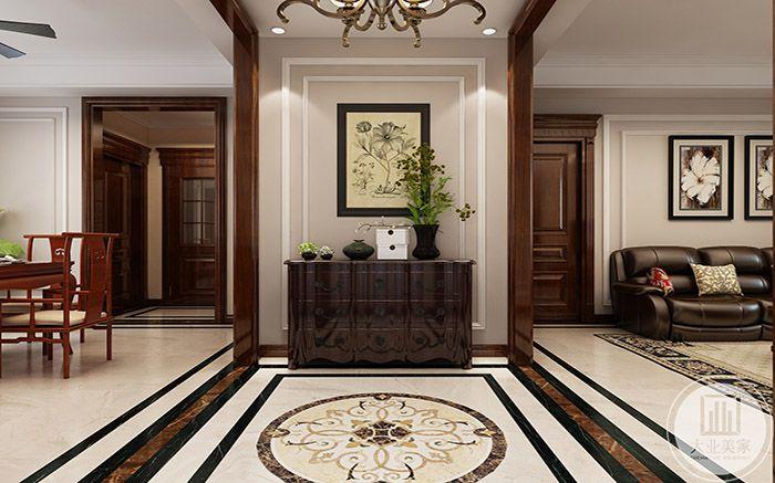 入户是深棕色置物柜,玄关上装饰着挂画