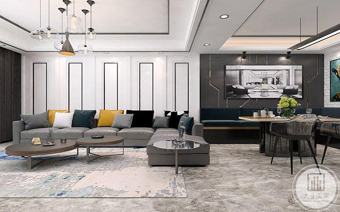 客厅主色调是黑白灰色系,间或有明黄,墨兰的抱枕,冲淡了冰冷的质感
